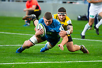 14th June 2020, Aukland, New Zealand;  Blues loose forward Dalton Papalii powers forward and scores during the Investec Super Rugby Aotearoa match, between the Blues and Hurricanes held at Eden Park, Auckland, New Zealand.