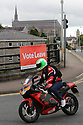 A motor cyclists passes a 'Vote Leave' poster fixed to a bridge in Enniskillen, County Fermanagh, Thursday, June 23rd, 2016, as voting got under way for the EU referendum on wether the United Kingdom should remain a member of the European Union or Leave the European Union.