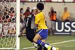 10 AUG 2010: Alexandre Pato (BRA) (9) collides with Tim Howard (USA) (1) as the ball crosses the goal line. The play was ruled a foul on Pato. The United States Men's National Team lost to the Brazil Men's National Team 0-2 at New Meadowlands Stadium in East Rutherford, New Jersey in an international friendly soccer match.