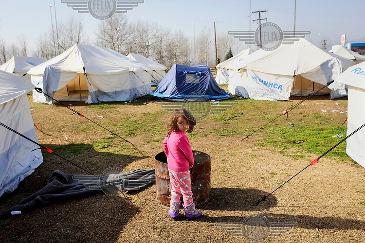 A refugee child in a camp at the Macedonian border which has been closed by the Macedonian authorities.