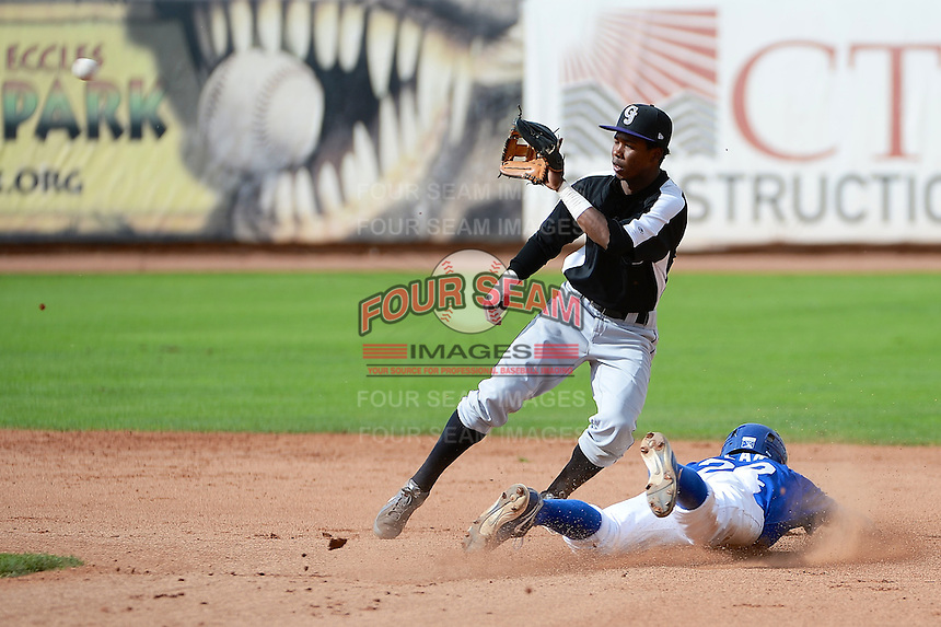 Adam Law (22) of the Ogden Raptors slides into second base against the Grand Junction Rockies while Rockies second baseman Cesar Galvez (2) waits for the throw in Pioneer League play at Lindquist Field on September 8, 2013 in Ogden Utah.  (Stephen Smith/Four Seam Images)