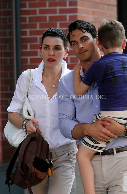 WWW.ACEPIXS.COM<br /> <br /> August 20 2013, New York City<br /> <br /> Actress Julianna Margulies, her husband Keith Lieberthal and their son Kieran walk in Greenwich Village on August 20 2013 in New York City<br /> <br /> By Line: Nancy Rivera/ACE Pictures<br /> <br /> <br /> ACE Pictures, Inc.<br /> tel: 646 769 0430<br /> Email: info@acepixs.com<br /> www.acepixs.com