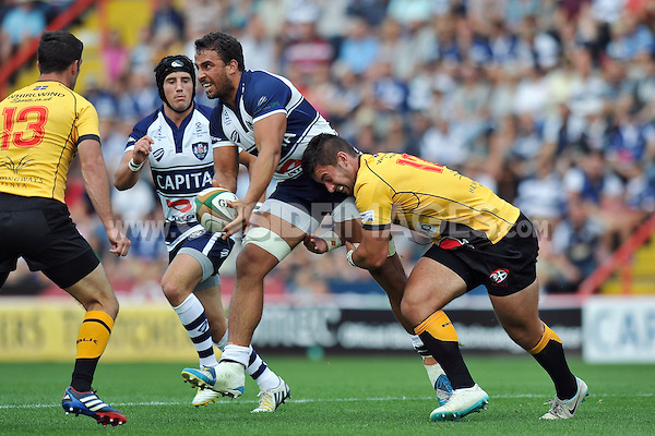 Marco Mama looks to offload the ball after being tackled. Greene King IPA Championship match, between Bristol Rugby and Cornish Pirates on September 21, 2014 at Ashton Gate in Bristol, England. Photo by: Patrick Khachfe / JMP