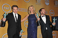 Bryan Cranston, Anna Gunn &amp; Aaron Paul at the 20th Annual Screen Actors Guild Awards at the Shrine Auditorium.<br /> January 18, 2014  Los Angeles, CA<br /> Picture: Paul Smith / Featureflash