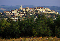medieval village, France, Quercy, the Dordogne, Europe, Tarn, Midi-Pyrenees, Cordes-sur-Ciel, Scenic view of the medieval hilltop village of Cordes-sur-Ciel with a vineyard in the foreground.