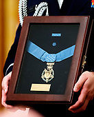 Close-up of the Congressional Medal of Honor that is being awarded posthumously to Technical Sergeant John A. Chapman, United States Air Force by US President Donald J. Trump during a ceremony in the East Room of the White House in Washington, DC on Wednesday, August 22, 2018.  Sergeant Chapman is being honored for his actions on March 4, 2002, on Takur Ghar mountain in Afghanistan where he gave his life to save his teammates.<br /> Credit: Ron Sachs / CNP