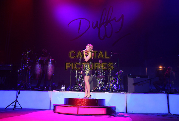DUFFY.performs in concert at The Carling Academy Brixton, London, England, December 8th 2008..music performing in concert live on stage full length microphone black tank top vest skirt gold striped mary janes .CAP/MAR.©Martin Harris/Capital Pictures