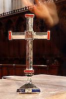 A l'église Sainte Clotilde de Paris, 7eme arrondissement, le 19 janvier 2011, Goudji remet la croix créée par ses soins au Père Matthieu Rougé, curé de la paroisse. Détail de la croix avec la main de Goudji en mouvement. In the Church Sainte Clotilde of Paris, in the 7th arrondissement, on January 19th, 2011, Goudji delivers the cross that he has created for the church to the priest Matthieu Rougé. Detail of the cross, Goudji's hand in movement on the right of the picture. Born in Georgia in 1941, Goudji has lived in Paris since 1974, due to the personal intervention of President Georges Pompidou. Here he produces his numerous contemporary works of goldsmithery in such widely differing fields as Church Art, swords, jewellery and sculpture. Picture by Manuel Cohen - Further clearance required, please contact us