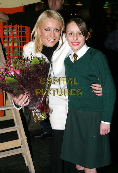 DENISE VAN OUTEN.Switching on the Christmas Lights At Marylebone High Street.20/11/2003.bouquet of flowers, with child, half length, half-length, arm around waist, painted nails, nail varnish.www.capitalpictures.com.sales@capitalpictures.com.© Capital Pictures.