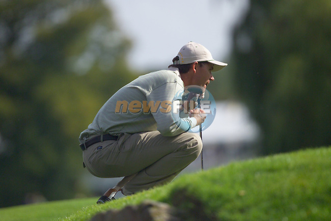 Straffin Co Kildare Ireland. K Club Ruder Cup...European Ryder Cup team member Padraig Harrington lines up his putt on 16th green on the opening fourball session on the first day of the 2006 Ryder Cup, at the K Club in Straffan, Co Kildare, in the Republic of Ireland, 22 September 2006..Photo: Eoin Clarke/ Newsfile.<br />