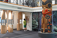 Young woman and James Hart totem pole in the Bill Reid Gallery of Northwest Coast Art, Vancouver, British Columbia, Canada