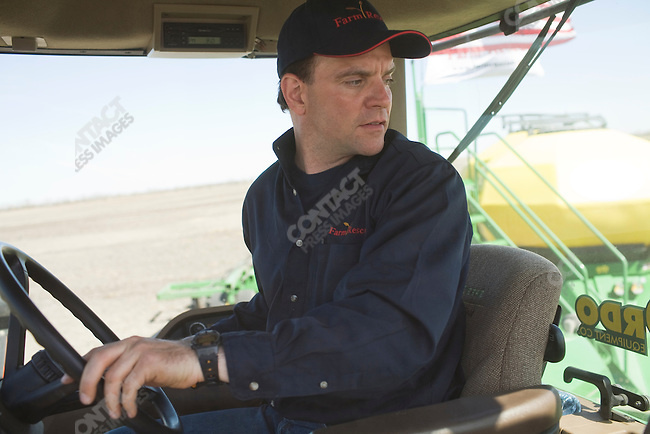Bill Gross, founder of Farm Rescue, a volunteer organization that plants and/or harvest crops for North Dakotan farmers unable to do so because of injury, plants on the Henderson family farm. Calvin, North Dakota, May 20, 2008.