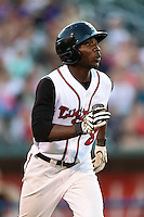 Lansing Lugnuts outfielder D.J. Davis (8) runs to first watching a home run during a game against the South Bend Silver Hawks on June 6, 2014 at Cooley Law School Stadium in Lansing, Michigan.  South Bend defeated Lansing 13-5.  (Mike Janes/Four Seam Images)