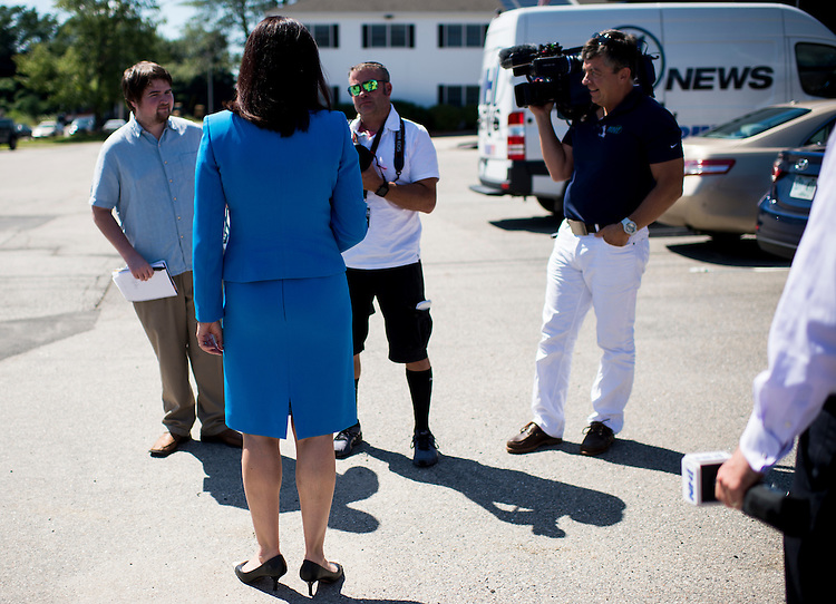 UNITED STATES - AUGUST 26: Sen. Kelly Ayotte, R-N.H., speaks with local media outlets as she arrives for a tour of Mikrolar Inc., a robotics company in Hampton, N.H., on Thursday, Aug. 27, 2015. (Photo By Bill Clark/CQ Roll Call)