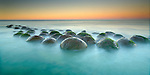 These sandstone concretions at Bowling Ball Beach, California, USA near Point Arena are much like the Moeraki boulders in New Zealand.