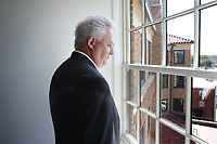 NWA Democrat-Gazette/DAVID GOTTSCHALK  Martin Shoppmeyer, superintendent of Haas Hall Academy, looks Tuesday, July 25, 2017, from a window on the south side of a classroom at the new Haas Hall Academy Rogers Campus in Rogers. The campus is in the former historic Lane Hotel in the Rogers Commercial Historic District.