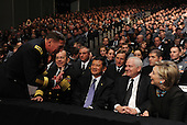 West Point, NY - December 1, 2009 -- General David Petraeus (standing) chats with Chairman of the Joint Chiefs of Staff Admiral Michael Mullen, Secretary of Veterans Affairs General Eric Shinseki , Secretary of Defense Robert Gates and Secretary of State Hillary Rodham Clinton (L to to R) as they wait for U.S. President Barack Obama to speak about his decision to increase U.S. troop levels in Afghanistan by about 30,000 during a speech at the U.S. Military Academy at West Point, New York, on Tuesday, December 1, 2009. The buildup is targeted to reverse the Taliban advances in the country and to train Afghan soldiers and police.     .Credit: Roger L. Wollenberg - Pool via CNP