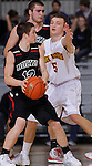 RAPID CITY, S.D. -- March 20, 2014 -- Colton Kooima #5 of Sioux Falls Roosevelt put pressure on Tanner Frick #12 of Yankton during their opening round game at the 2014 South Dakota State AA Boys Basketball Tournament at the Barnett Arena in Rapid City Thursday. (Photo by Dick Carlson/Inertia)