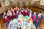 Help the Humans :Students from Scoil Realta Na Madna, Listowel presenting house hold and personal hygiene products collected by the themselves to Angela Norgrove & Mamie Stack  of  the Irish Wheelchair shop, Listowel who are the collection agents for Help The Humans - Kerry at the school on Friday last.