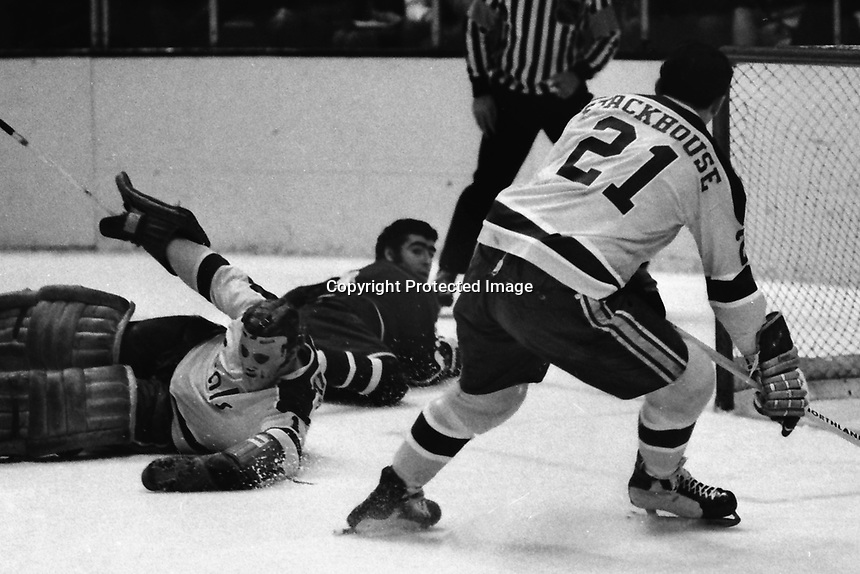 Seals vs Vancouver Canucks 1971. Seal golie Gary Smith upended, Ron Stackhouse helps. (photo/Ron Riesterer)
