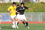 Torrance, CA 01/24/12 - Kenji Sato (Peninsula #21) and unidentified West Torrance player(s) in action during the Peninsula vs West Torrance CIF Bay league game.