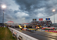 Sep 1, 2017; Clermont, IN, USA; NHRA top fuel driver Clay Millican (near) races alongside Terry McMillen during qualifying for the US Nationals at Lucas Oil Raceway. Mandatory Credit: Mark J. Rebilas-USA TODAY Sports