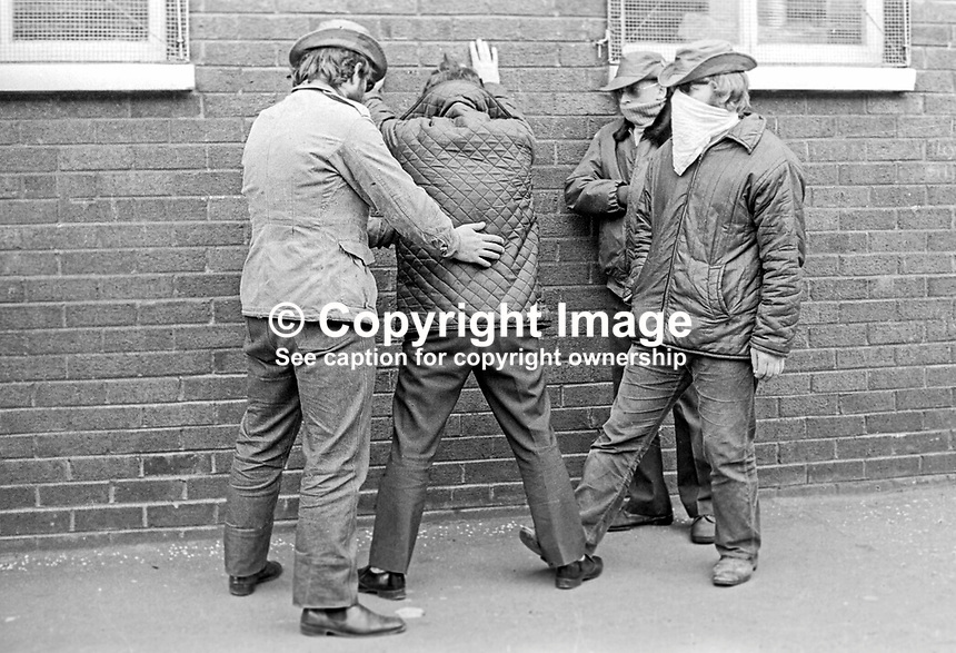 Masked members of the loyalist para-military Ulster Defence Association frisk a &quot;stranger&quot; at a checkpoint in the predominently Protestant Woodvale district of Belfast, N Ireland, UK, on 14th May 1972. 197205140563e<br />