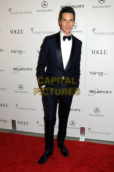 "CAMERON SILVER .attends the Art of Elysium 4th Annual Charity Gala ""Heaven"" held at The Annenberg Building at The California Science Center in Los Angeles, California, USA, January 15th 2011..full length black tuxedo bow tie tux hands in pockets .CAP/ADM/BP.©Byron Purvis/AdMedia/Capital Pictures."