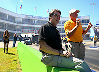 Sept. 21, 2013; Ennis, TX, USA: Texas governor Rick Perry (left) reacts with track owner Billy Meyer on the starting line during NHRA qualifying for the Fall Nationals at the Texas Motorplex. Mandatory Credit: Mark J. Rebilas-