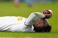 Tammy Abraham of Swansea City lies on the pitch injured during the Premier League match between Burnley and Swansea City at Turf Moor, Burnley, England, UK. Saturday 18 November 2017