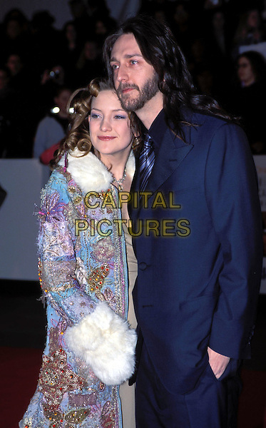 KATE HUDSON & CHRIS ROBINSON.(Black Crowes).Bafta Arrivals.Ref: 10400.Hugging, cuddling, blue suit, coat, fur.sales@capitalpictures.com.www.capitalpictures.com.©Capital Pictures.