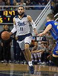 Nevada Cody Martin (11) brings the ball up the court against South Dakota State in the first half of an NCAA college basketball game in Reno, Nev., Saturday, Dec. 15, 2018. (AP Photo/Tom R. Smedes)