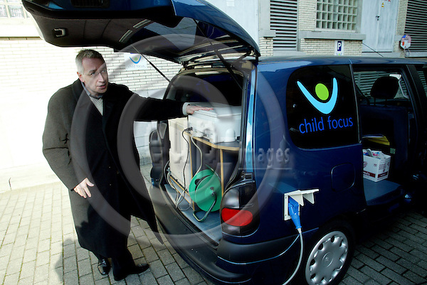 BRUSSELS - BELGIUM - 24 FEBRUARY 2004--Daniel CORNELIS, Co-ordinator Technics and Logistics at Child Focus, with the special van, car, where they can print out posters of missing children on the spot.-- PHOTO: ERIK LUNTANG / EUP-IMAGES