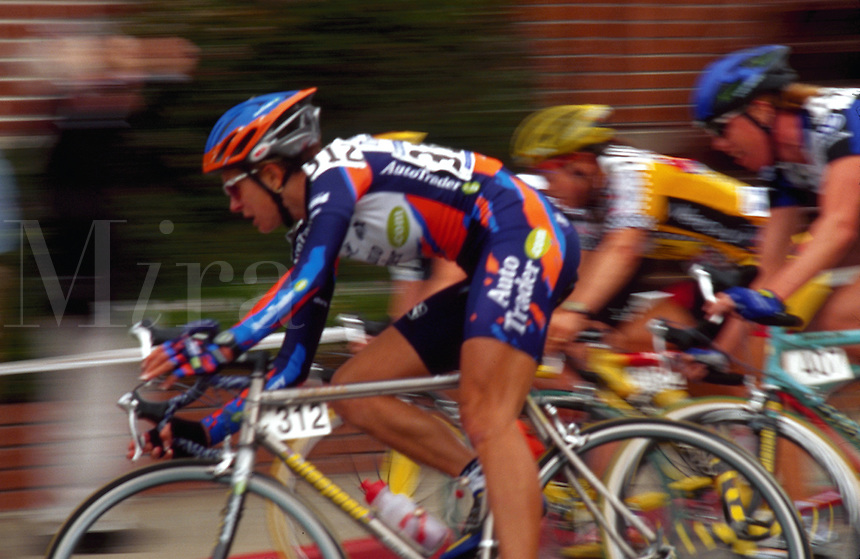 Blurred motion image of cyclists in competition.