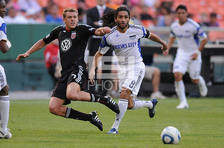 DC United forward Adam Cristman (7) makes a pass against Kansas City Wizards  midfielder Stephane Auvray (8).  DC United defeated The Kansas City Wizards  2-0 at RFK Stadium, Wednesday  May 5, 2010.