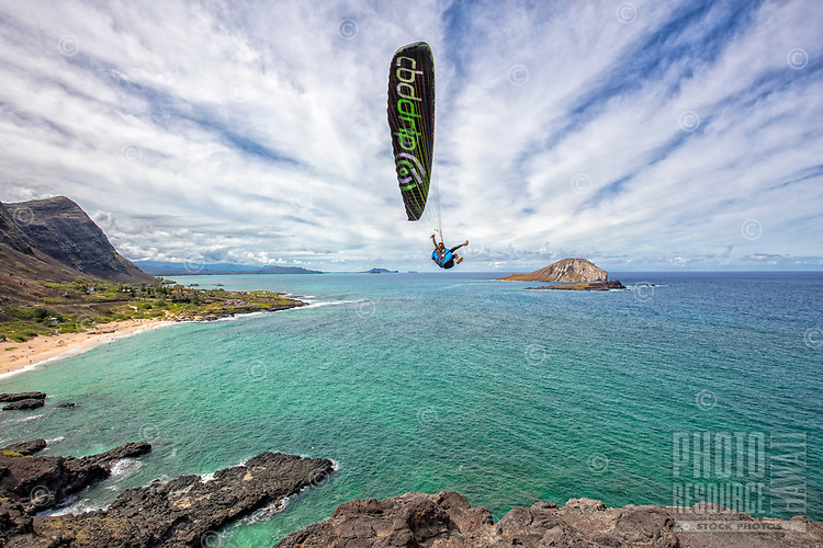 Paraglider over Makapu'u, East O'ahu; Rabbit and Bird Islands are to the right and the Windward coast is in the distance.
