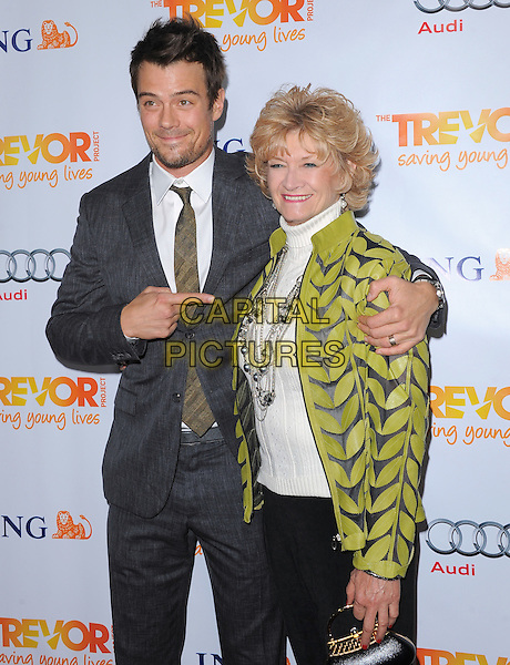 Josh Duhamel & his mother, Bonny.Trevor Live at The Hollywood Palladium in Hollywood, California, USA..December 4th, 2011  .half length grey gray suit black green print jacket mom mum son family  hand pointing arm around shoulder .CAP/RKE/DVS.©DVS/RockinExposures/Capital Pictures.