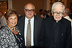 WATERBURY CT. 17 July 2017-071717SV04-From left, Emma Barone of Waterbury, Ralph Carpinella of Woodbury and Rev. Ronald Ferraro attend a dinner to honor the retiring Rev. Ferraro at La Bella Vista in Waterbury Monday. After 57 years of service, the Rev. Ferraro will retire as pastor of Our Lady of Lourdes Church, where he has served since 1990<br /> Steven Valenti Republican-American