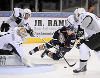 San Antonio Rampage goaltender Dov Grumet-Morris (1) makes a save on a shot by Oklahoma City Barons' Teemu Hartikainen (10), made as he is taken down by Rampage's Colby Robak, right rear, Nolan Yonkman, right, and Jared Gomes, during the first period of an AHL hockey game, Sunday, Nov. 4, 2012, in San Antonio. (Darren Abate/pressphotointl.com)