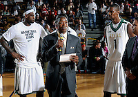 Florida International University Head Basketball Coach Isiah Thomas with NBA players Dwyane Wade, LeBron James, and Chris Bosh at a half-time check presentation at the South Florida All Star Classic held at FIU's U.S. Century Bank Arena, Miami, Florida. .