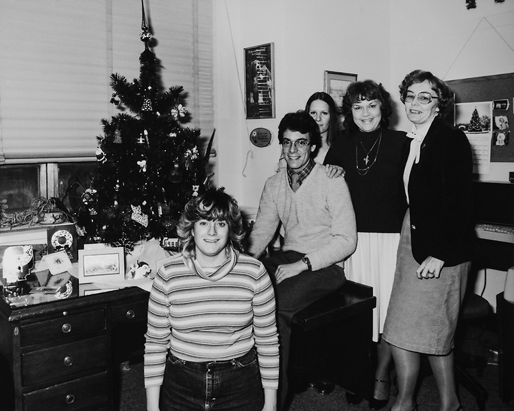 Rep. Glenn with staff in his decorated office during Christmas in 1982. (Photo by CQ Roll Call via Getty Images)