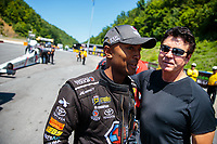 Jun 16, 2018; Bristol, TN, USA; NHRA top fuel driver Antron Brown (left) with Papa Johns Pizza founder John Schnatter during qualifying for the Thunder Valley Nationals at Bristol Dragway. Mandatory Credit: Mark J. Rebilas-USA TODAY Sports