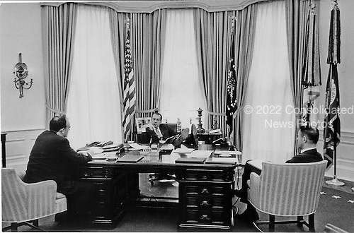 "United States President Richard M. Nixon, center, meets in the Oval Office in the White House in Washington, D.C. with John D. Ehrlichman, Domestic Affairs Advisor, left and Harry Robbins ""H.R."" Haldeman, Chief of Staff, right, on December 19, 1969..Credit: White House via CNP"