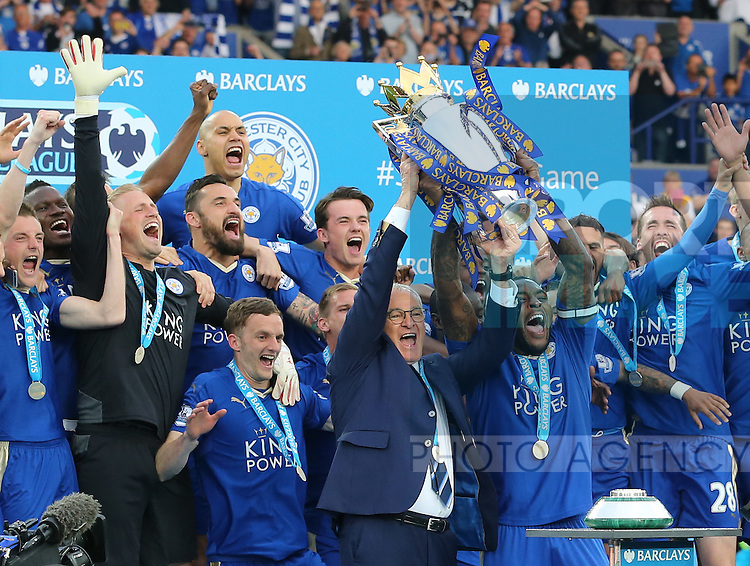Leicester's Wes Morgan and Claudio Ranieri celebrate with the trophy during the Barclays Premier League match at the King Power Stadium.  Photo credit should read: David Klein/Sportimage