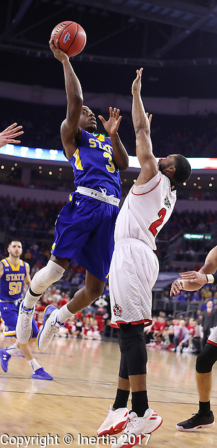 SIOUX FALLS, SD: MARCH 6: Chris Howell #3 of South Dakota State shoots over Carlton Hurst #2 of South Dakota  during the Summit League Basketball Championship on March 6, 2017 at the Denny Sanford Premier Center in Sioux Falls, SD. (Photo by Dick Carlson/Inertia)