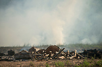 NWA Democrat-Gazette/BEN GOFF @NWABENGOFF<br /> Smoke rises Thursday, Aug. 2, 2018 from an underground fire at the former 'stump dump' site on Trafalgar Road in Bella Vista. The fire began some time last weekend when the property owner was burning above-ground brush piles, according to Cassi Lapp, communications manager for the city of Bella Vista. The site was once a Bella Vista Property Owners Association 'stump dump' where residents of the city could dump yard waste, said Lapp. The dump, which is 40-60 feet deep, has been closed and covered over for some time and is now privately owned, said Lapp. The Bella Vista Fire Department posted on their facebook page Wednesday saying they were monitoring the fire but there is 'no safe way at this time for us to put out the fire.' Lapps said the fire department estimates the fire could burn underground for months.