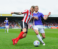Lincoln City's Harry Anderson vies for possession with Exeter City's Dean Moxey<br /> <br /> Photographer Chris Vaughan/CameraSport<br /> <br /> The EFL Sky Bet League Two Play Off First Leg - Lincoln City v Exeter City - Saturday 12th May 2018 - Sincil Bank - Lincoln<br /> <br /> World Copyright &copy; 2018 CameraSport. All rights reserved. 43 Linden Ave. Countesthorpe. Leicester. England. LE8 5PG - Tel: +44 (0) 116 277 4147 - admin@camerasport.com - www.camerasport.com