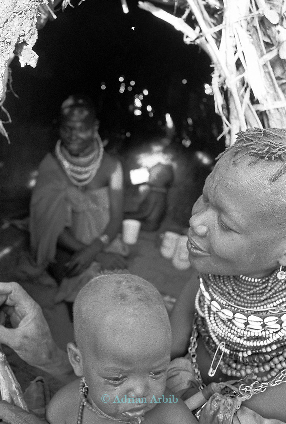 Turkana mother and child in a traditional village nr Kakuma, Northern Kenya.