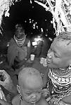 Turkana mother and child in a traditional village nr Kakuma, Northern Kenya.
