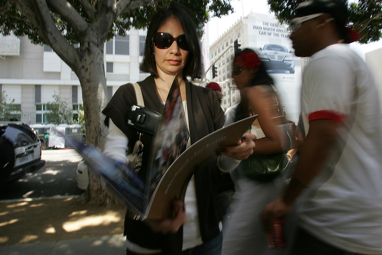 Jennifer Martinez, 39 of Los Angeles displays a memento of the Michael Jackson Memorial service she attended  while mourning fans and the lucky few who attended the memorial service of the pop icon crowd the sidewalks near Staples center in downtown Los Angeles Calif. Friday July 7, 2009.(Gerard Burkhart Photo).818-207-0273